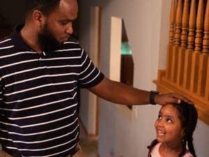 Ahmed Issahak talk to his 4-year-old daughter, Leyan.