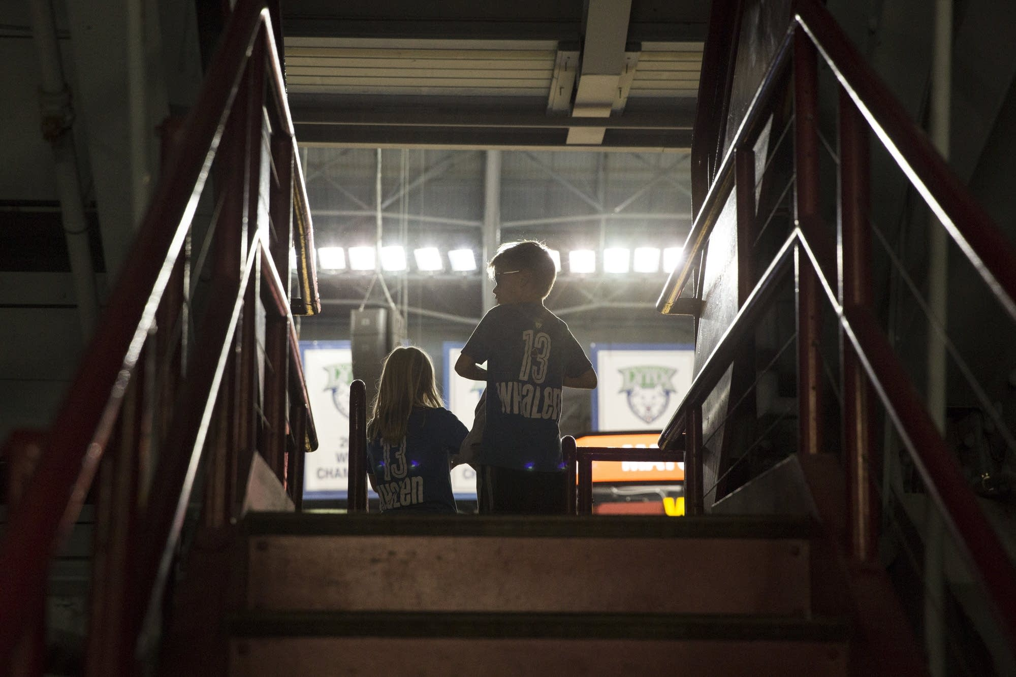 Two children watch the game from the upper deck.