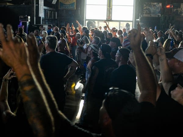 People cheer during a concert at the Full Throttle Saloon