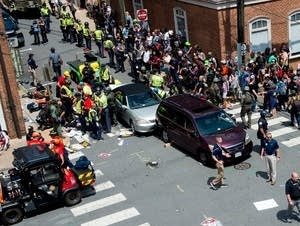 People receive first-aid after a car accident ran into a crowd