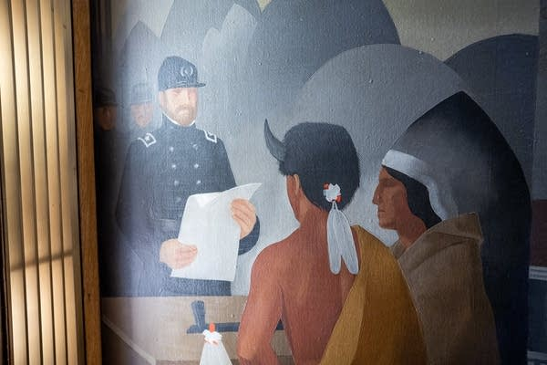 A mural inside the St. Paul City Council chamber depicts Native Americans.