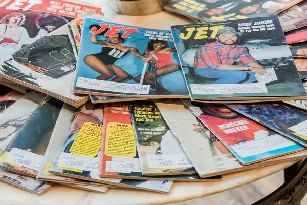 Jet magazines are fanned out on a table.