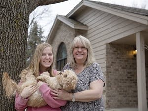 Lynn Cordova, right, poses with her daughter, Sydney, and their dog, Jack.