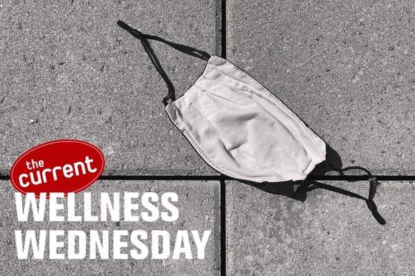 Discarded mask with Wellness Wednesday logo.