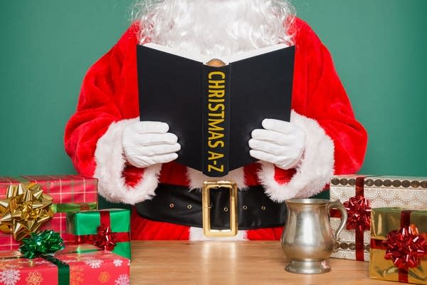 "Stock image of Santa reading book ""Christmas A - Z"""