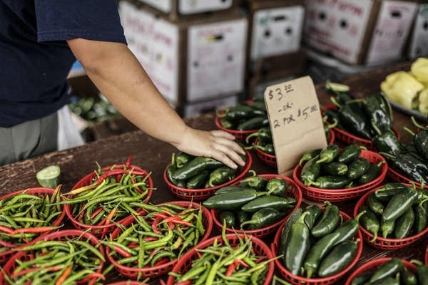 Mao Lee from Lee Farms produces and grows vegetables in Eagan