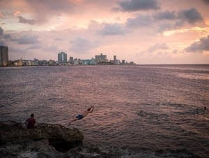 Boys swam and dived off the Malecon