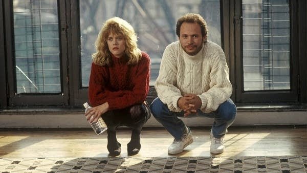 """Meg Ryan & Billy Crystal crouching in """"When Harry Met Sally"""""""