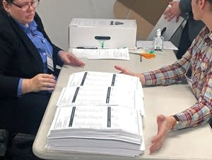 Minneapolis elections officials start sorting ballots.