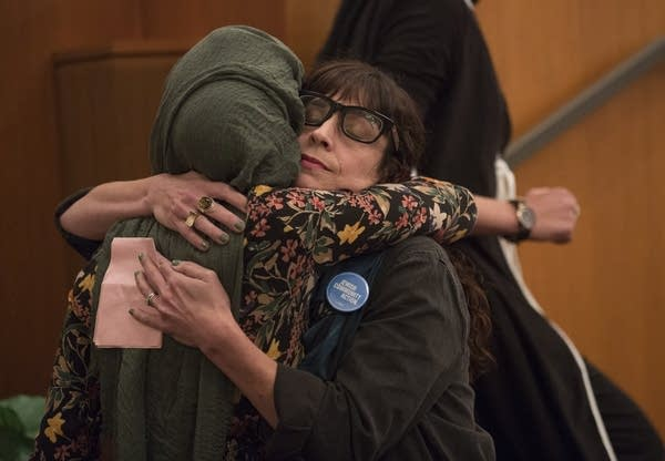 Carin Mrotz of the JCA, right, receives a hug.