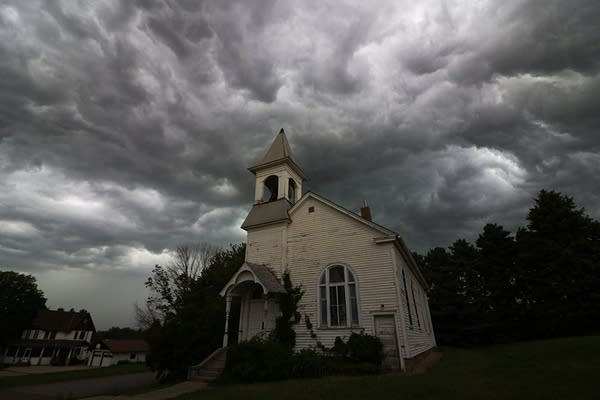 Turbulent storm clouds swirl in the sky above Cleveland, Minn.