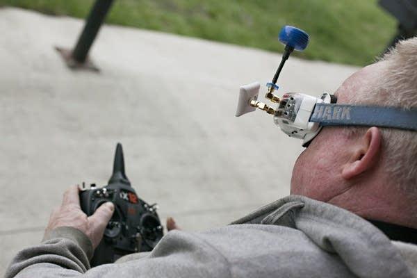 Pilot Shawn Spears of Moorhead, Minn., maneuvers his drone during a race.