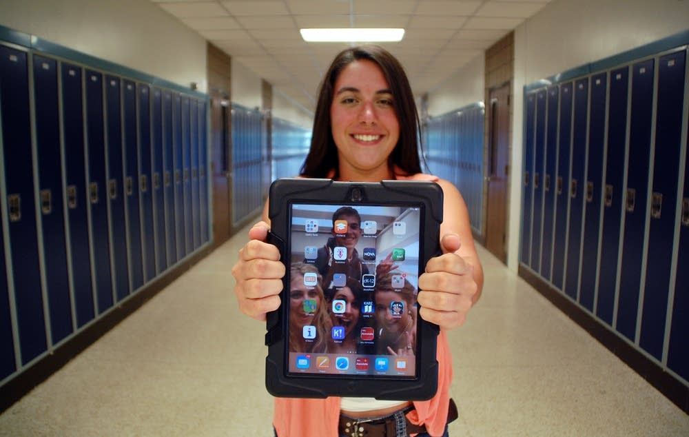 Andrea Howard has a district-provided iPad.