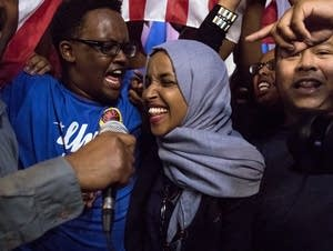 Ilhan Omar dances onstage with her supporters after her primary victory.