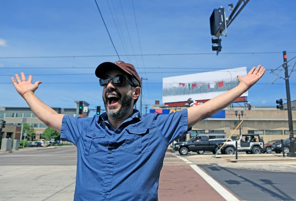 Alec Soth celebrates unveiling of his billboard.