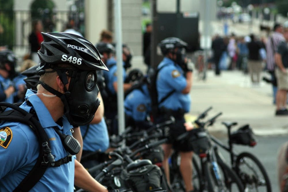 Bicycle police don gas masks during the RNC