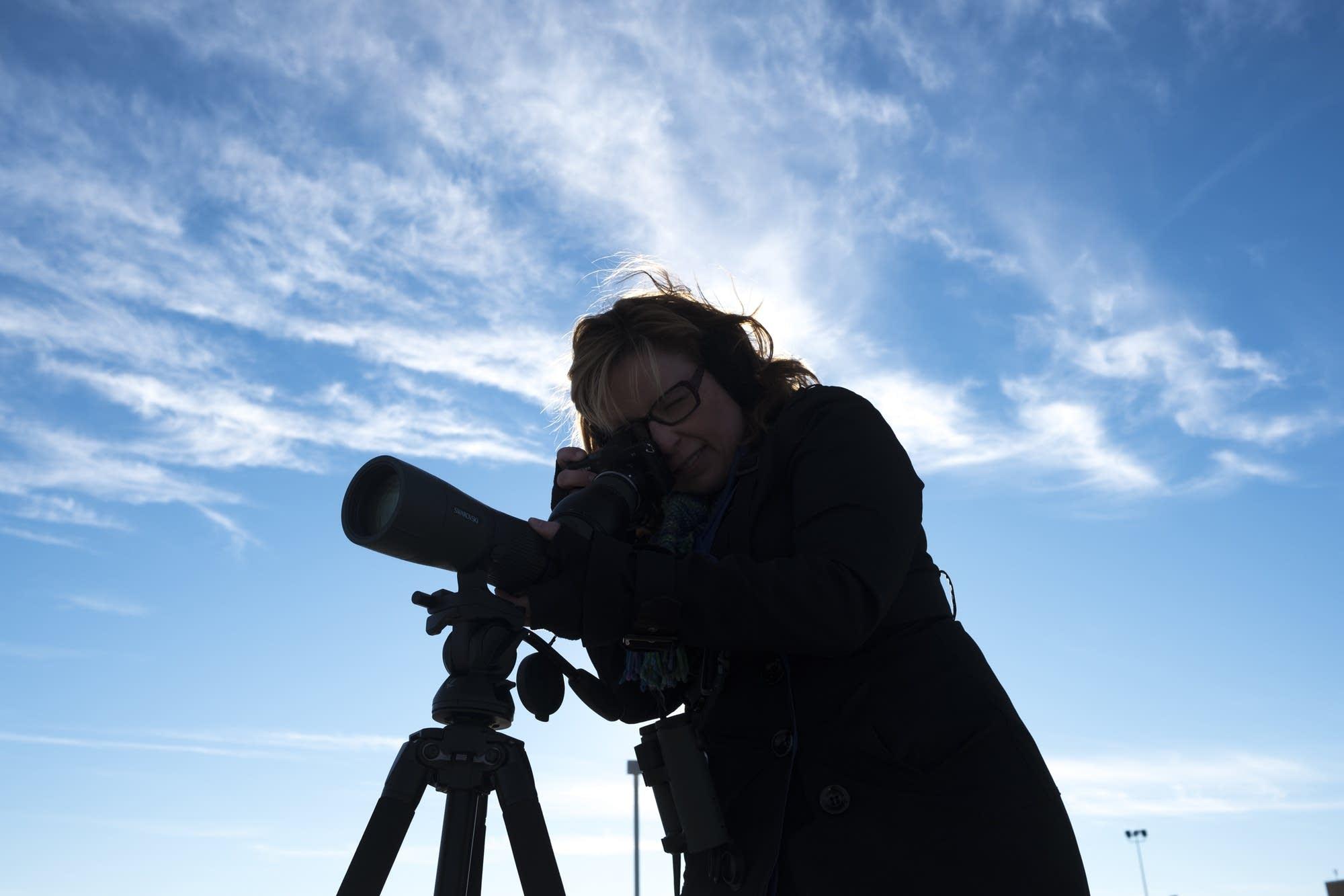 Sharon Stiteler uses a spotting scope.
