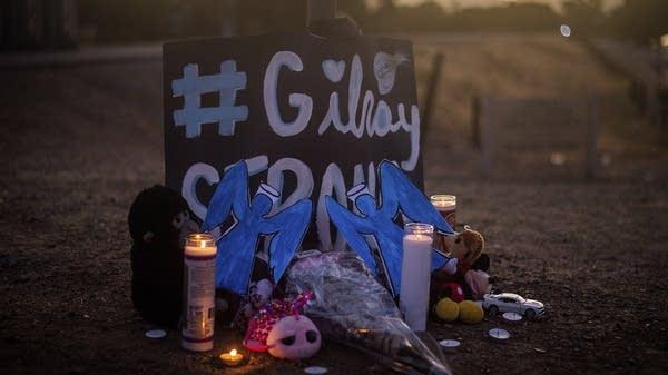 Candles burn at a memorial for Gilroy Garlic Festival shooting victims