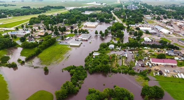 Masten Creek floods homes and businesses in Kasson, Minn.