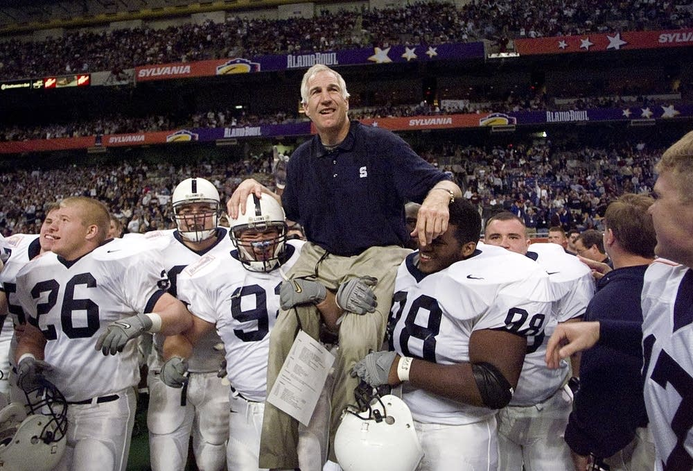 Jerry Sandusky with Penn State players