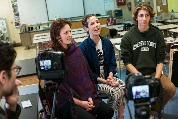 St. Louis Park High School iMatter members are interviewed on camera.