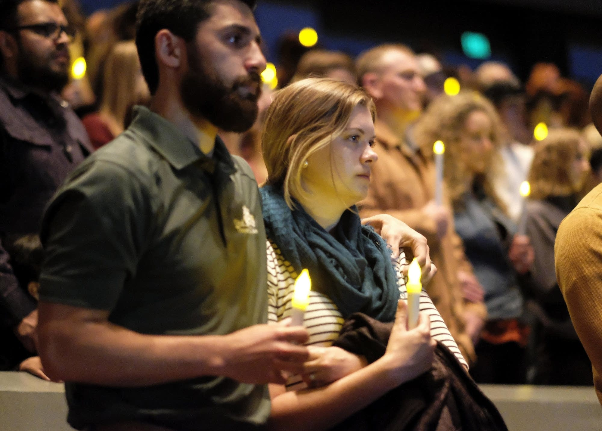 People gather to pray for the victims of the shooting.