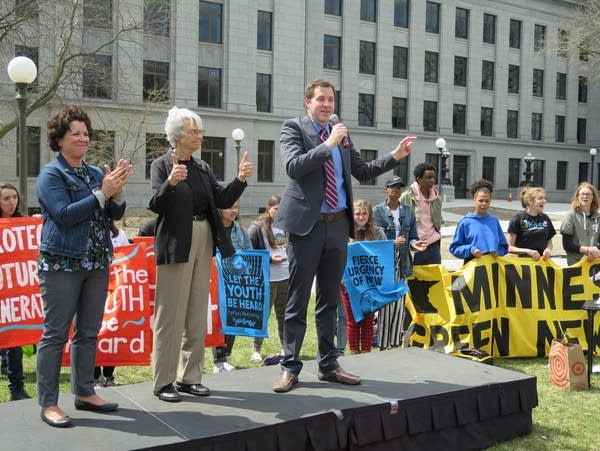 Rep. Jamie Long speaks at a Youth Climate Strike rally.