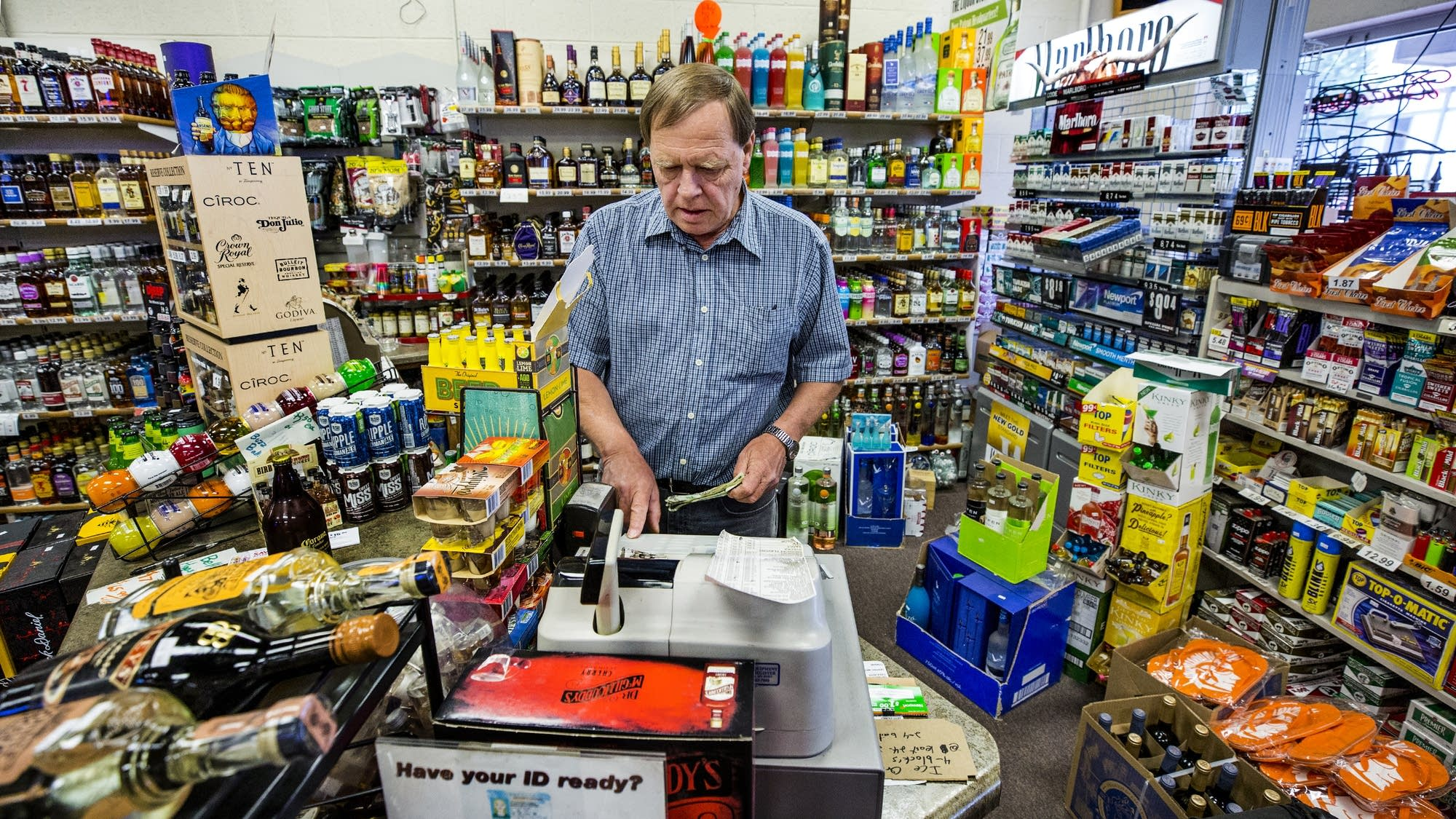 Liquor Shoppe on 25th employee Chuck Fleegel works the register.