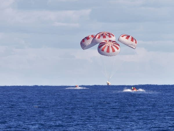 The SpaceX capsule splashes down