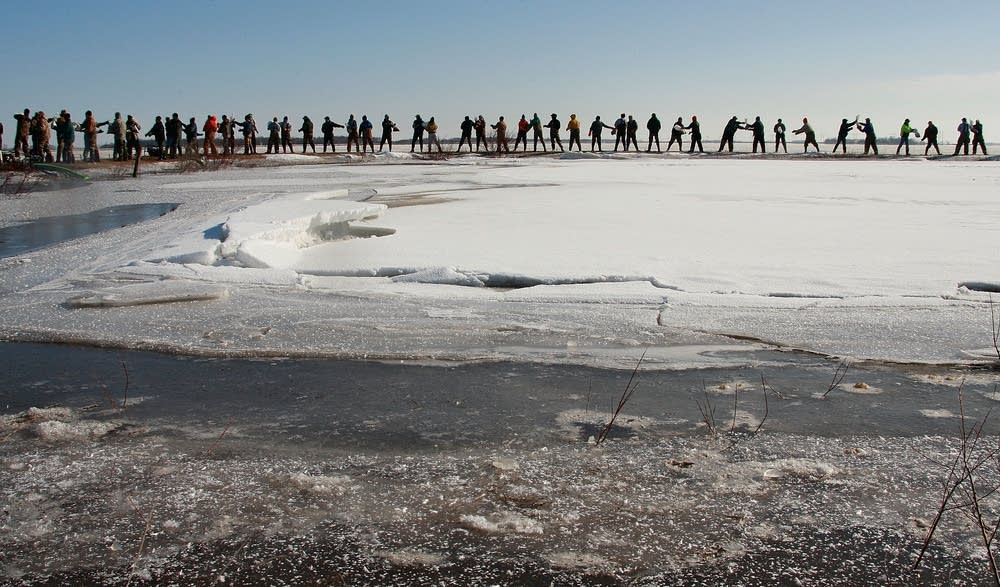 Volunteers form a long line to help sandbag