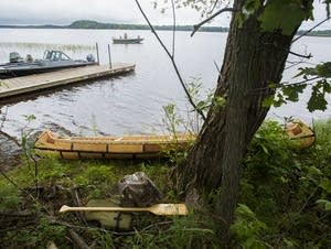 A birch bark canoe rests on Big Sandy Lake