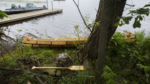 A birch bark canoe rests on Big Sandy Lake