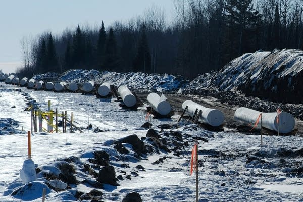 Sections of pipe in in the snow.