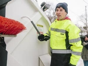 Jacob Frey gets ready to help out an organics recycling team.