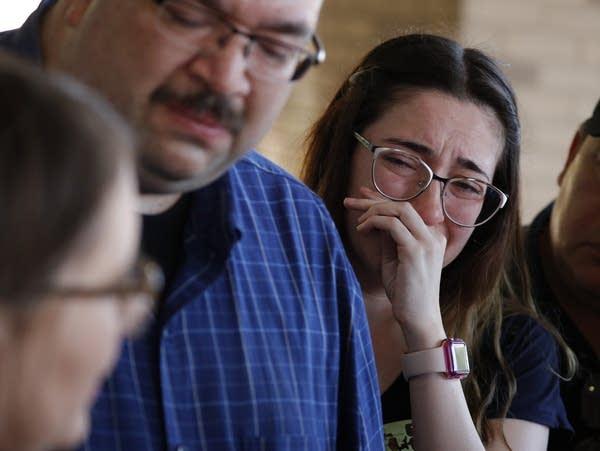 Leta Jamrowski wipes away tears as her parents speak