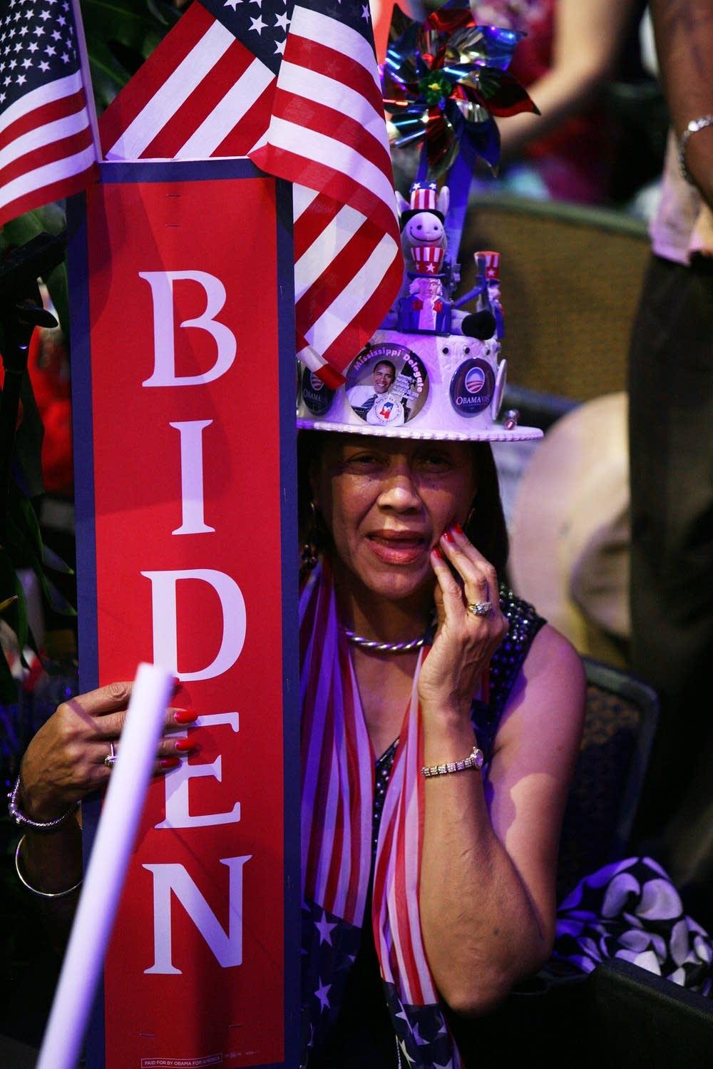 A delegate holds a Biden sign