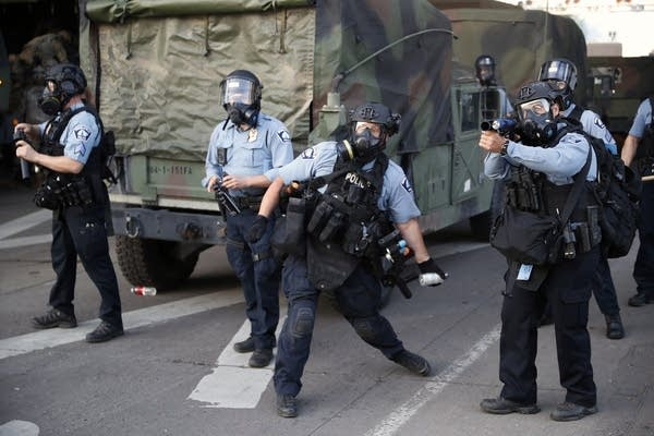 Police toss teargas at demonstrators