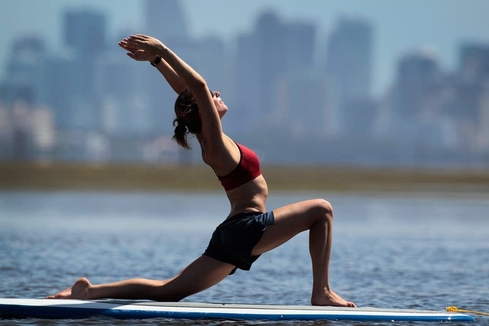 Practicing paddleboard yoga