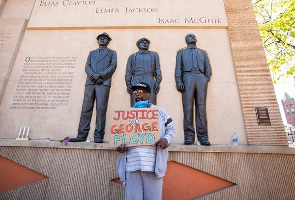 Jemel Jones stands in front of the Clayton-Jackson-McGhie Memorial
