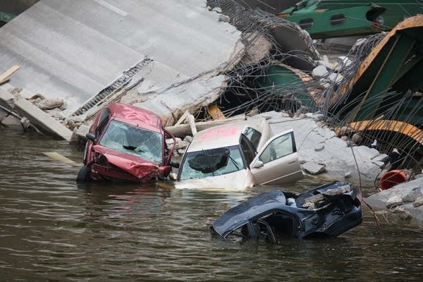 Partially submerged cars await removal from the Mississippi River.