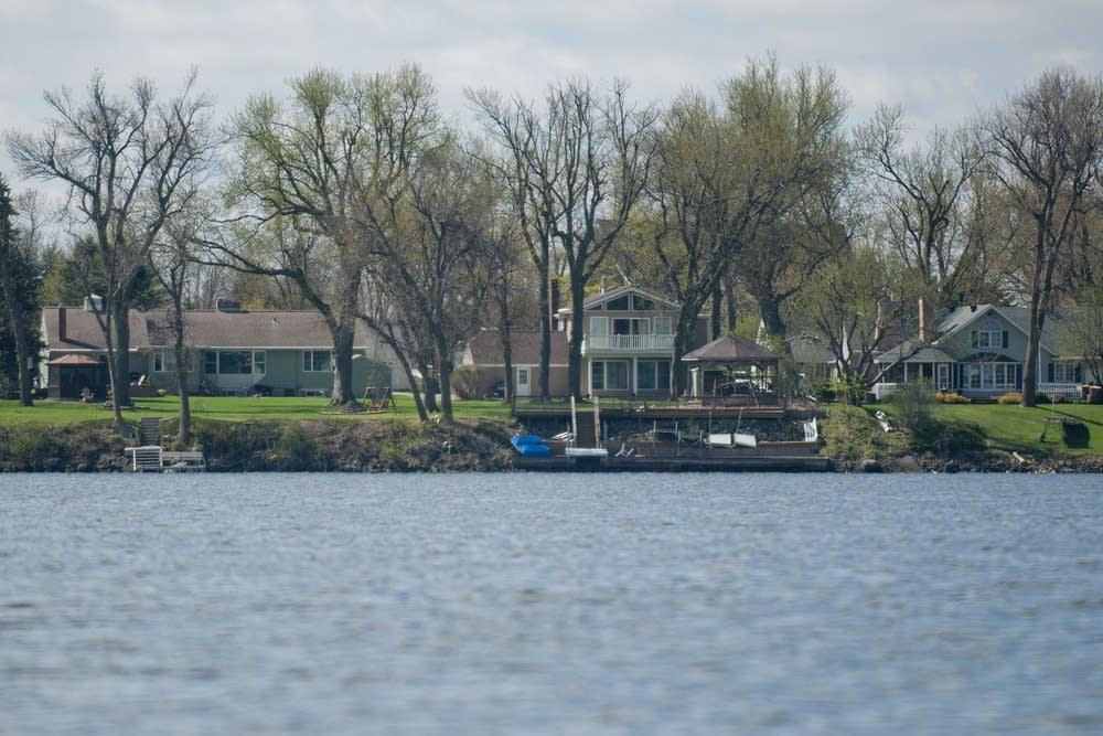 Houses line the shore of Okabena Lake