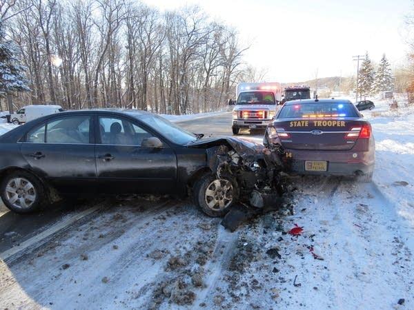 A damaged car that struck a MN State Patrol squad car.
