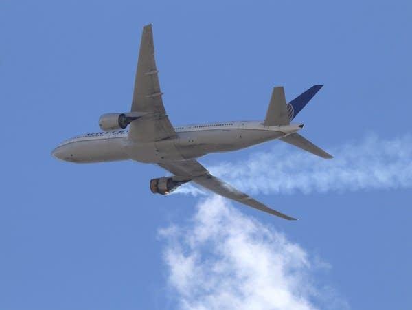 A plane trails a cloud of smoke