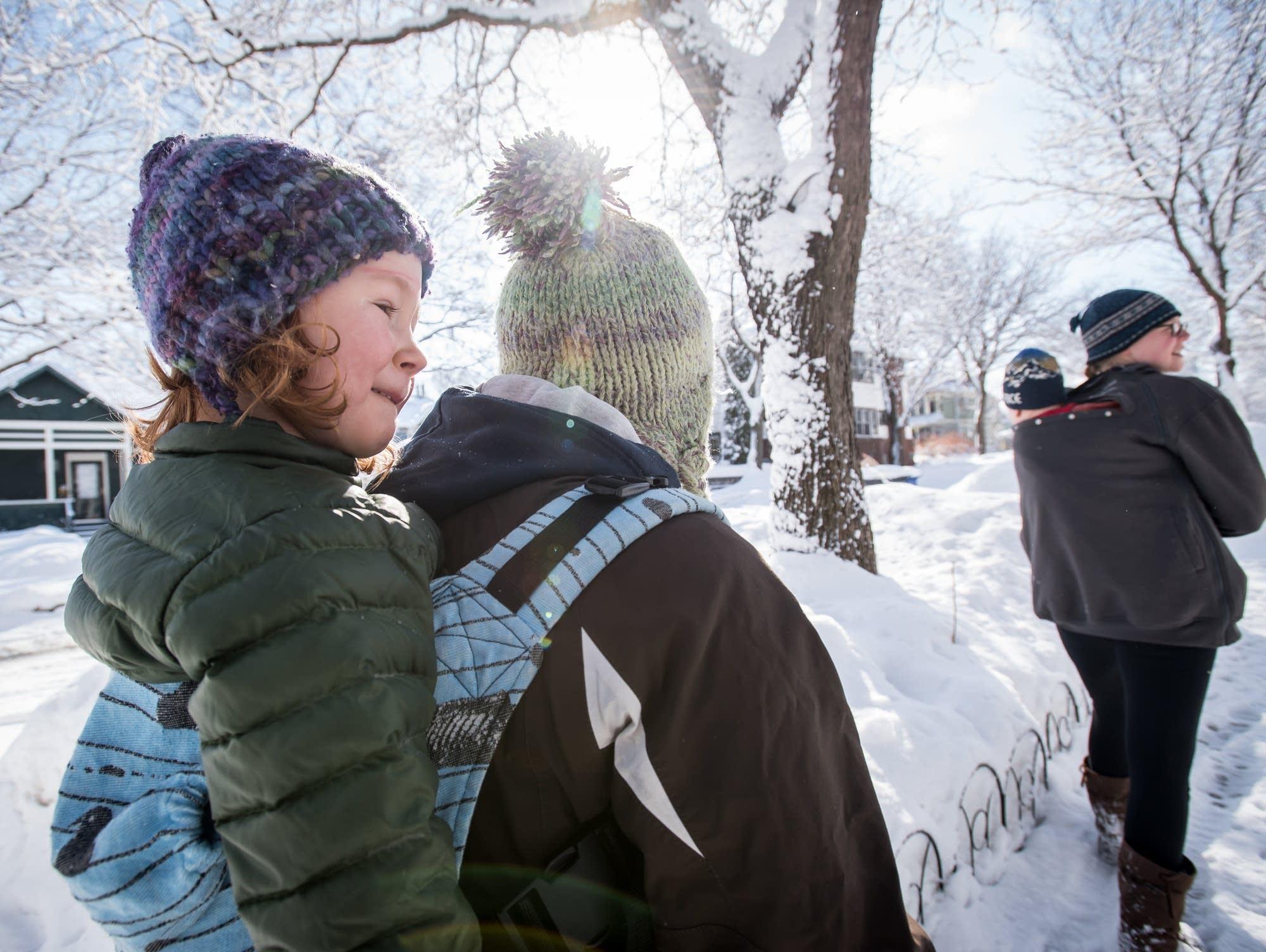 Grace Blanchard-Hinz, 4, rides on her mom Colleen Hinz's back