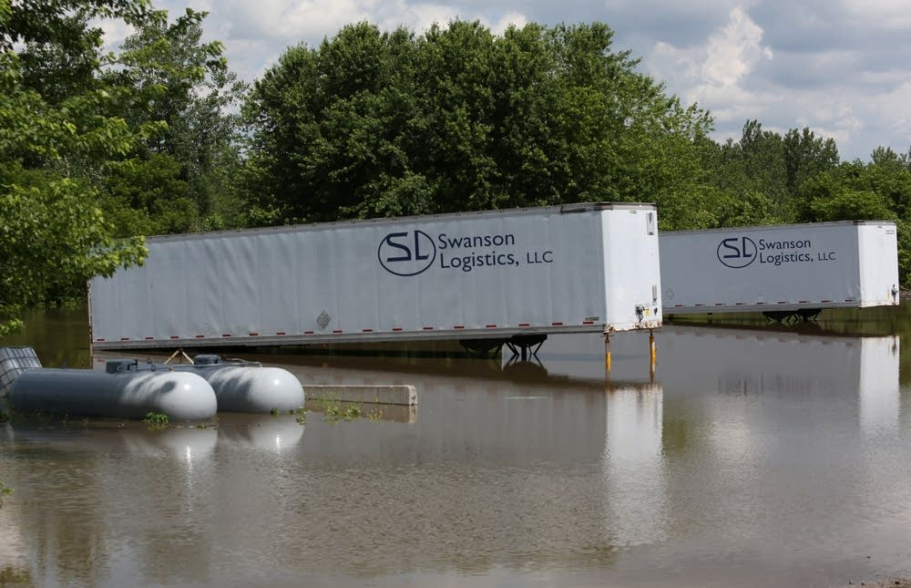 Trailers sit in the water.