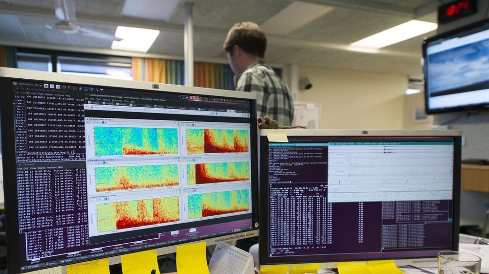 Computer screens show seismic activity