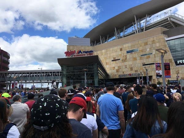 Twins fans wait in long lines at Target Field.