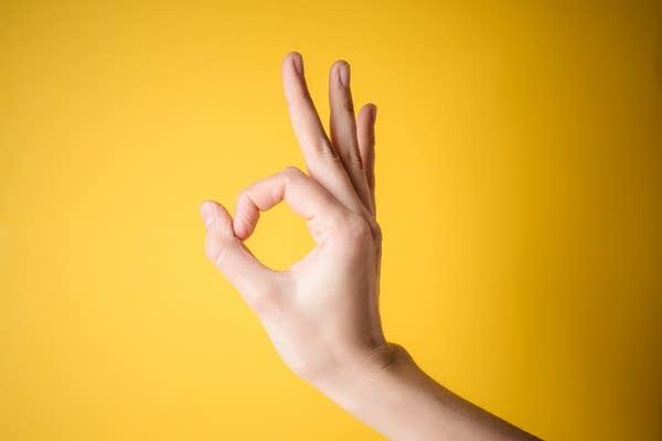 "Hand making the ""Okay"" symbol"