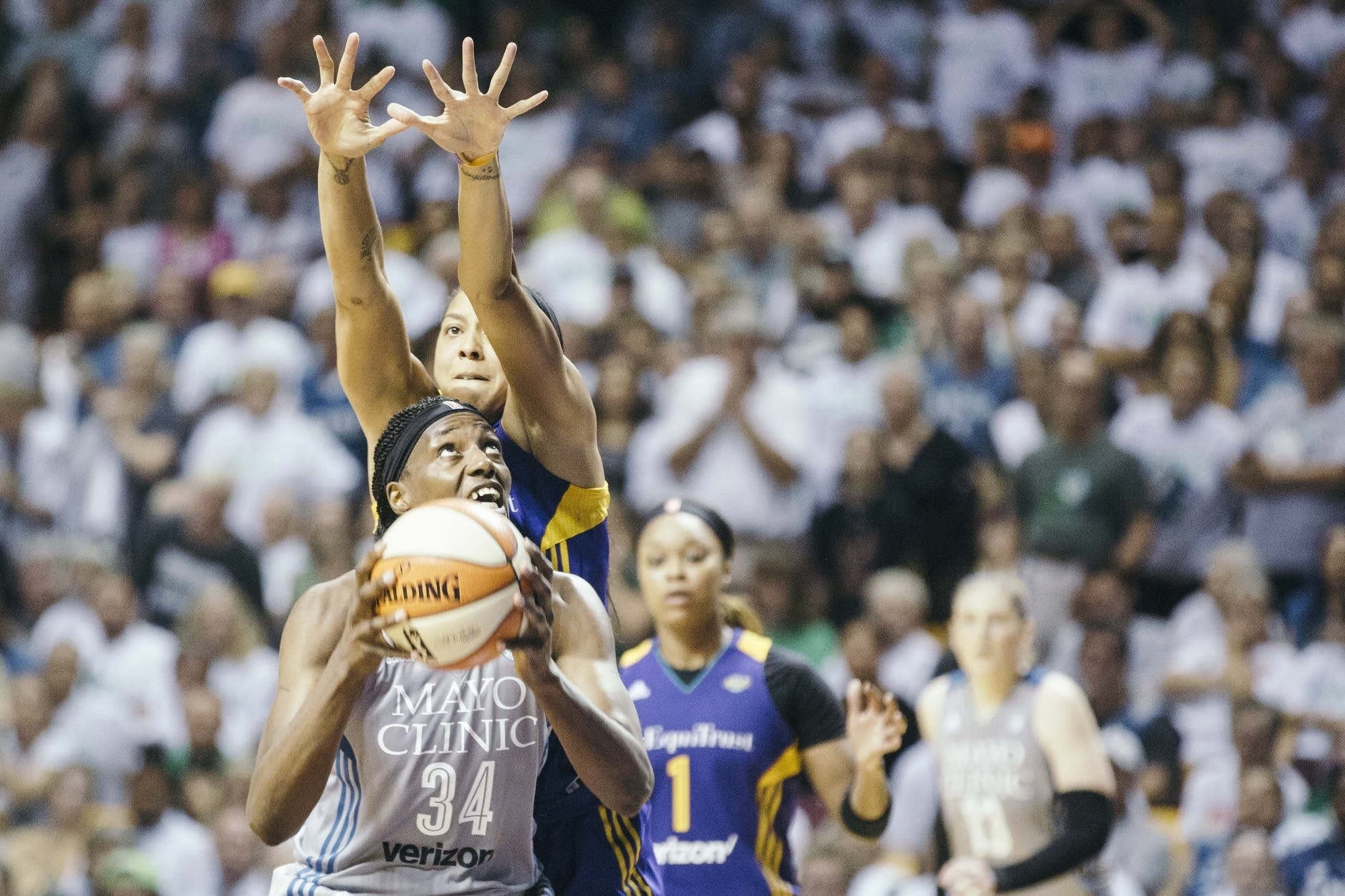 Minnesota Lynx Center Sylvia Fowles looks up at the rim.