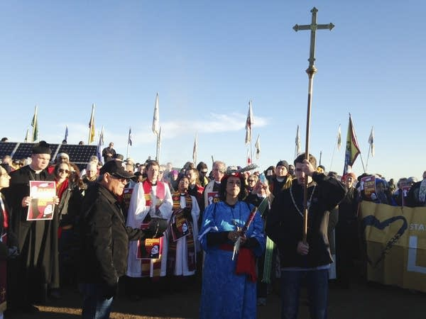 Members of the clergy join protesters